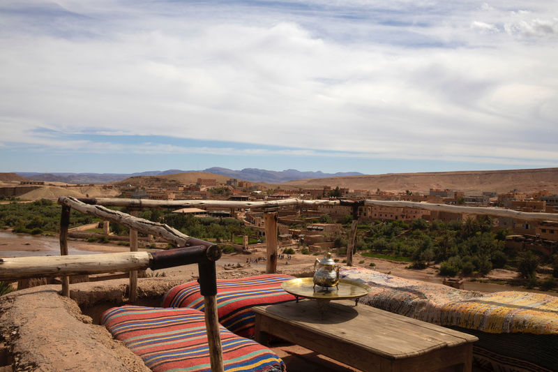 Ksar Ksar Ait Ben Hadu Ksar Ait Benhaddou Kasbah Morocco Earthen Building Old World Heritage World Heritage Site Massive Sky Cloud - Sky Nature Landscape Absence No People Day Environment Seat Chair Land Mountain Table Tranquility Scenics - Nature Beauty In Nature Tranquil Scene Outdoors Wood - Material Empty Sofa Bench Tea View