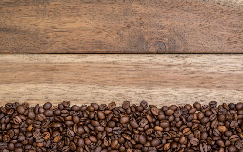 Coffee beans on wooden background Backgrounds Bean Brown Cafe Close-up Coffee Coffee Bean Coffee Cup Copy Space Cup Freshness Glass Indoor Mug Nature No People Outdoors Still Life Wood Wood - Material Wooden