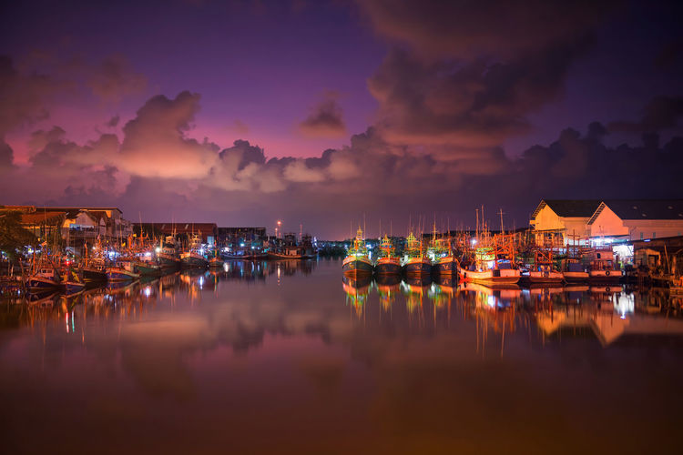 fishing ships or boats at Pak Nam Rayong River port or dock with twilight sky and river reflection at dawn. Rayong,Thailand Skyline Twilight Architecture Building Building Exterior Built Structure Cloud - Sky Dawn Harbor Illuminated Marina Nature Nautical Vessel Night No People Reflection Sailboat Scenics - Nature Sea Sky Tranquility Transportation Water Waterfront