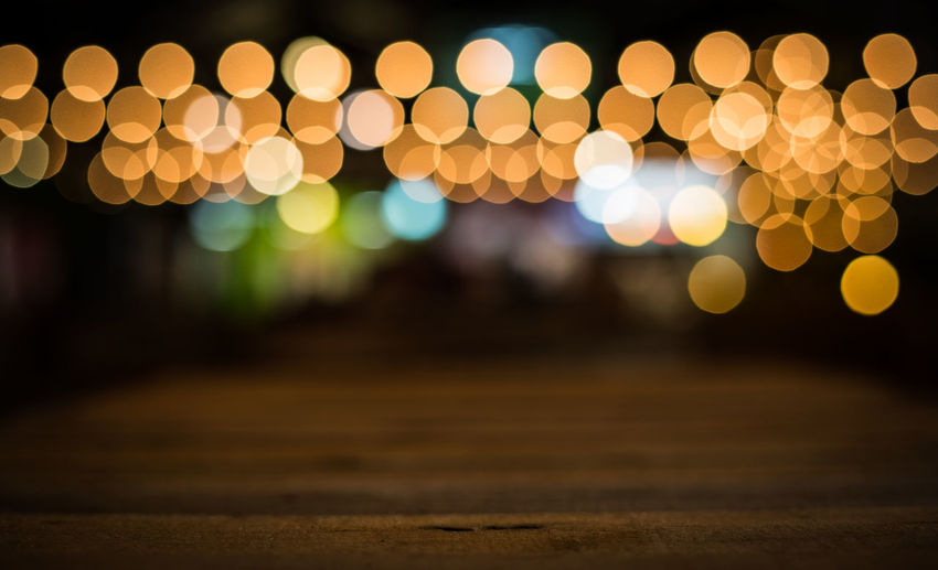 Defocused image of illuminated yellow lights