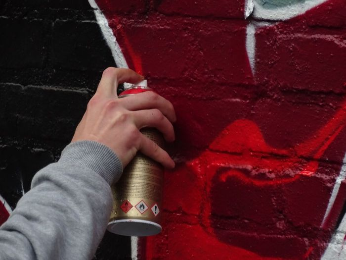 Cropped Image Of Person Making Graffiti On Wall
