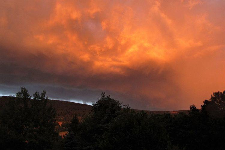 Drammatic Sky Cloud - Sky Clouds Dusk Evening Landscape Mountain Nature No People Orange Color Outdoors Scenics - Nature Silhouette Sky Sunset Tree