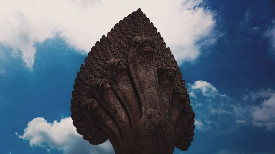 Low angle view of naga statue against sky