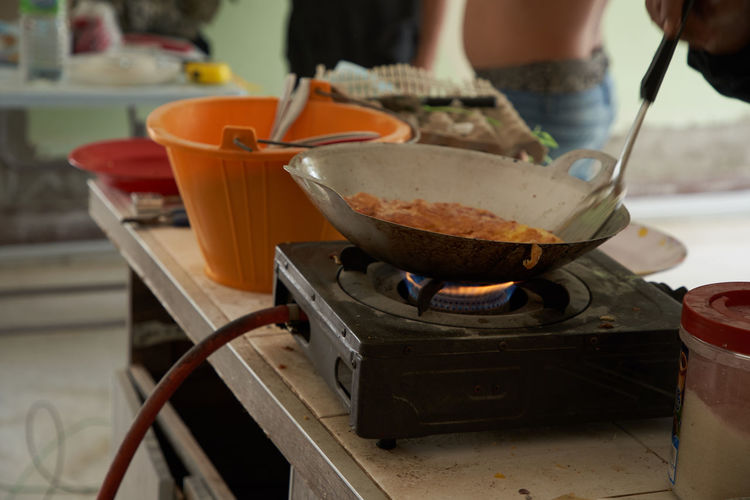 Midsection of man preparing food in kitchen