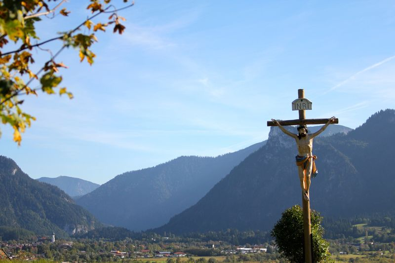 Sculpture Of Jesus Christ On Cross In Mountains
