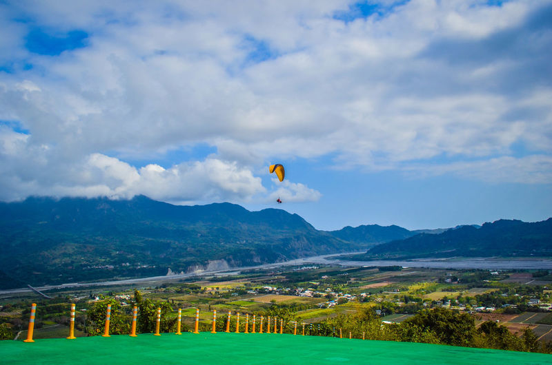 Sky Cloud - Sky Environment Nature Beauty In Nature Day Mountain Scenics - Nature No People Plant Mid-air Tree Flying Landscape Outdoors Field Land Balloon Tranquil Scene Grass Paragliding Paraglider Paragliders Paragliding Fun