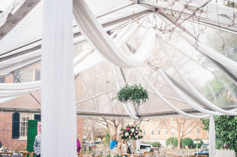 wedding reception under a clear tent with hanging florals and linen drapery. Classic Hanging Plants Reception Wedding Photography Weddings Around The World Architecture Building Exterior Built Structure Clear Day Drapes  Floral Photography Florals Hanging Light Indoors  No People Tent Wedding Day
