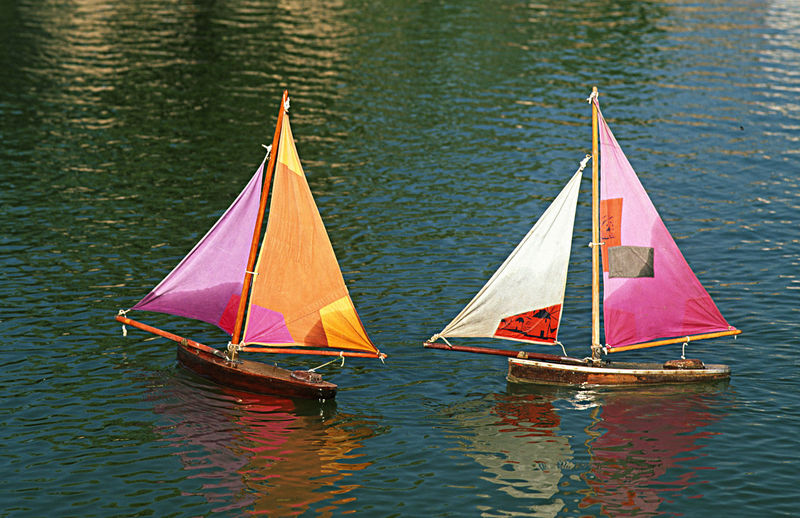 High angle view of sailing boats sailing in sea