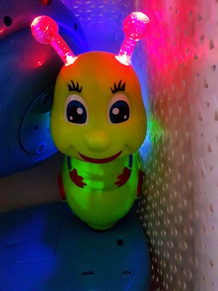 Indoors  Close-up Neon Life Play Time Playing With The Light Playing With Toys Toddlerlife Toddler  Toys Multi Colored EyeEmNewHere Home Is Where The Art Is Colored Lights Green Caterpillar Smile Face Happiness Imagination Childhood Creativity