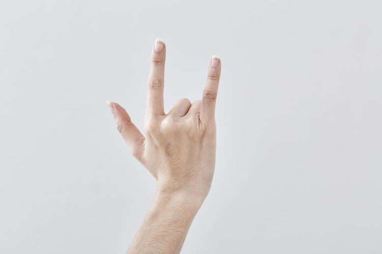 Body Part Close-up Communication Copy Space Finger Form Of Communication Gesturing Hand Hand Sign Human Body Part Human Finger Human Hand Human Limb Indoors  One Person Pointing Showing Studio Shot Success Unrecognizable Person White Background