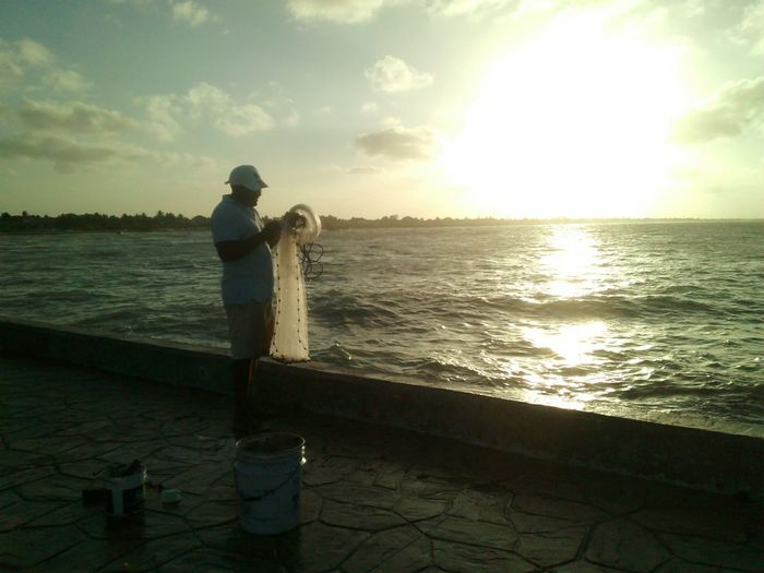 Fisherman Fishing Net Fishing Time Sunset Silhouettes People And Places People And Nature Sealife♡ Yucatán, México PuertoProgresoYucatan First Eyeem Photo
