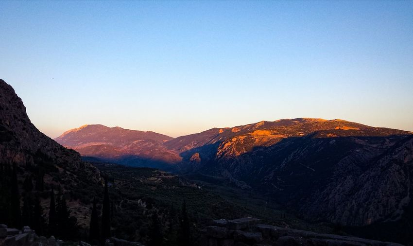 Scenic view of mountains against clear sky during sunset