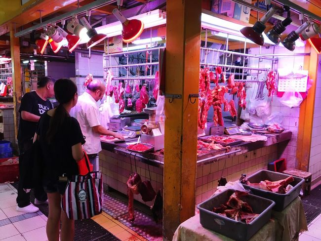 Meats and Cleavers HKWetMarkets HongKong Wet Markets Meat Real People Retail  Women Market Stall Group Of People Business Shopping