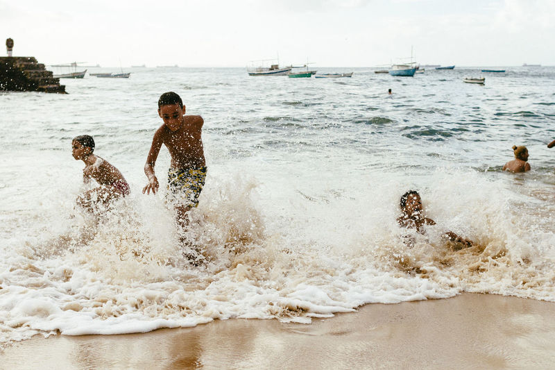 Bahia/brazil Beach Childhood Happiness Kids Being Kids Leisure Activity Live For The Story Motion People Porto Da Barra Salvador Bahia Sand Sea Shirtless Splashing Vacations Water Wave Waves Crashing Place Of Heart The Street Photographer - 2017 EyeEm Awards