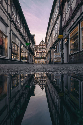 Reflection of buildings in water during dusk