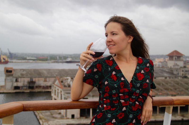 Cuba Havana Travel Wine Not Wine moments Wine Tasting Alcohol Architecture Building Exterior Cruise Cruising Drink Drinking Holding Lifestyles One Person Outdoors Railing Red Wine Refreshment Smiling Wine Wineglass Young Adult Young Women