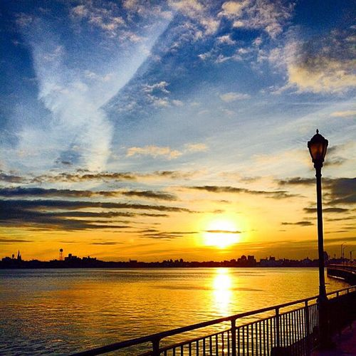 Sky and light over the East river, NYC Atmosphere Atmospheric Mood Beauty In Nature Cloud Cloud - Sky Clouds Dusk Lampost Light Majestic Nature Outdoors River Scenics Silhouette Sky Sunset Tranquil Scene Tranquility Water