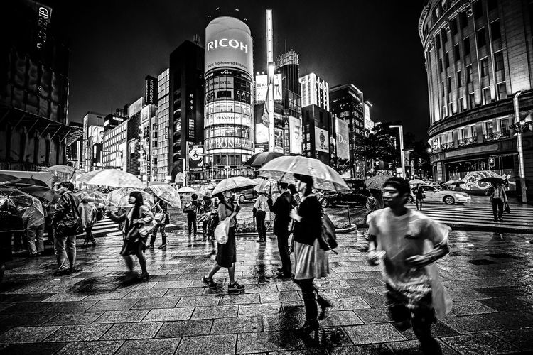 """""""Stopping Time"""" Architecture Building Exterior Built Structure City City Life Crowd Illuminated Large Group Of People Leisure Activity Lifestyles Men Night Outdoors People Rain Rainning Real People Sky Skyscraper Travel Destinations The Street Photographer - 2017 EyeEm Awards EyeEm Selects Fresh on Market 2017 Stories From The City The Street Photographer - 2018 EyeEm Awards The Art Of Street Photography My Best Photo"""