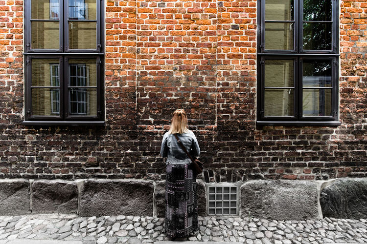 Explore... / from my brick wall edition - (c) Nidal Sadeq Gradient Imagination Adult Adults Only Architecture Brick Brick Wall Building Exterior Built Structure City Cold Temperature Day Full Length Looking One Person One Woman Only One Young Woman Only Outdoors People Portrait Real People Standing Window Young Adult