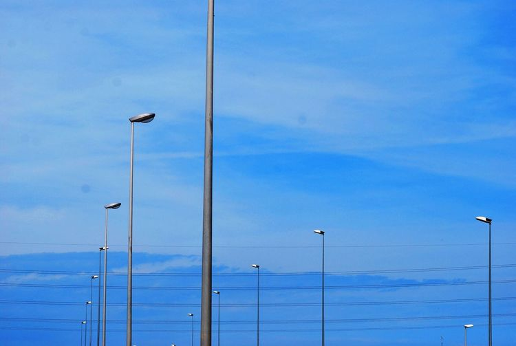 View Of Street Lights Against Blue Sky