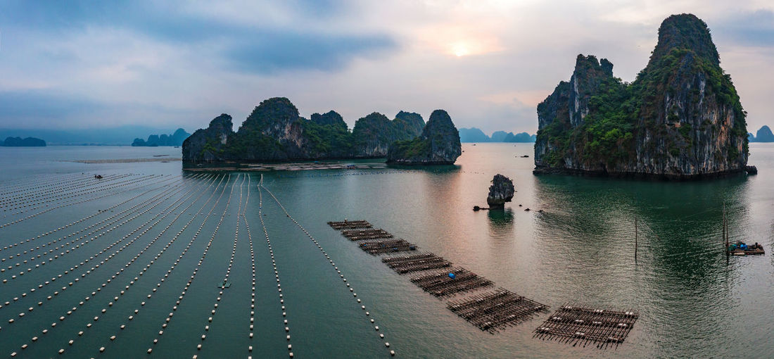Bay Ha Long Bay Sky Sea Water Nature Scenics - Nature Beauty In Nature Cloud - Sky Transportation Rock Tranquil Scene Tranquility Land Idyllic Non-urban Scene Nautical Vessel Rock - Object Rock Formation Day Solid Outdoors Stack Rock