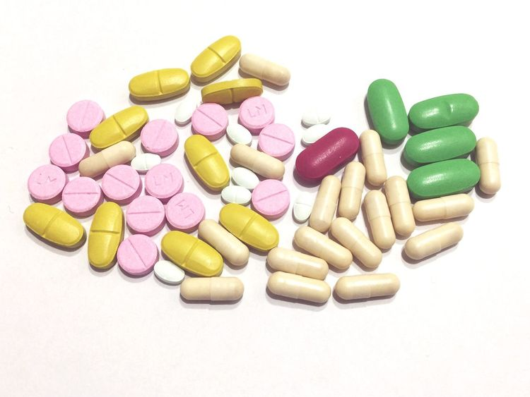 Pill Medicine Capsule Healthcare And Medicine Nutritional Supplement Vitamin Large Group Of Objects Studio Shot White Background Prescription Medicine Variation No People Close-up Pink Color Multi Colored Alternative Medicine PainKiller Dose Antibiotic IPhone
