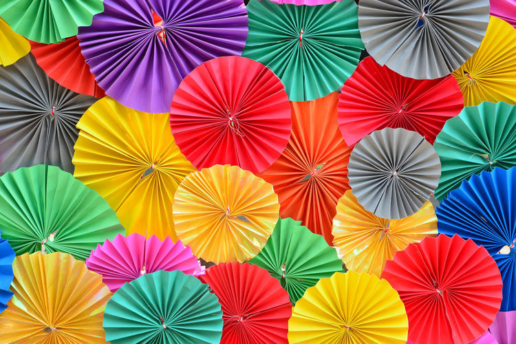 Full frame shot of multi colored umbrellas at market