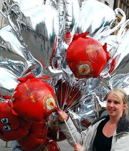 Adult Balloon Celebration Christmas Christmas Decoration Close-up Day Happiness Helium Balloon Lifestyles Manchester United MANCHESTER UNITED FC One Person Outdoors People Real People Red Smiling Young Adult Young Women