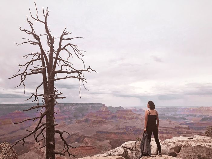 Rear view of woman standing at grand canyon national park