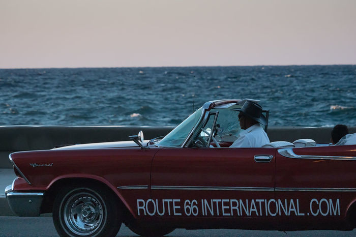 Malecón before sunset Afternoon Sunlight Cockpit Cuba Cuba Collection Cuban Cars Day Hat Horizon Over Water Malecon Old-fashioned Outdoors Sea Tourist Attraction  Travel Photography