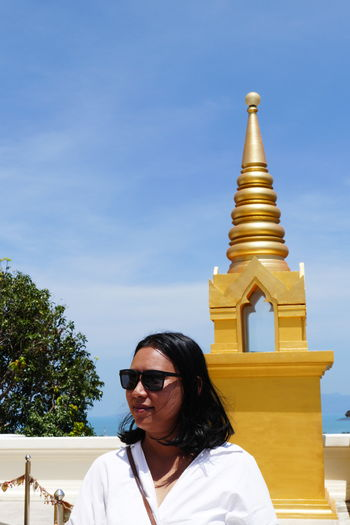 Glasses Sky Built Structure Real People Building Exterior Religion Nature Spirituality Sunglasses One Person Day Fashion Outdoors Women Adult Portrait Of A Woman Thailand_allshots Belief