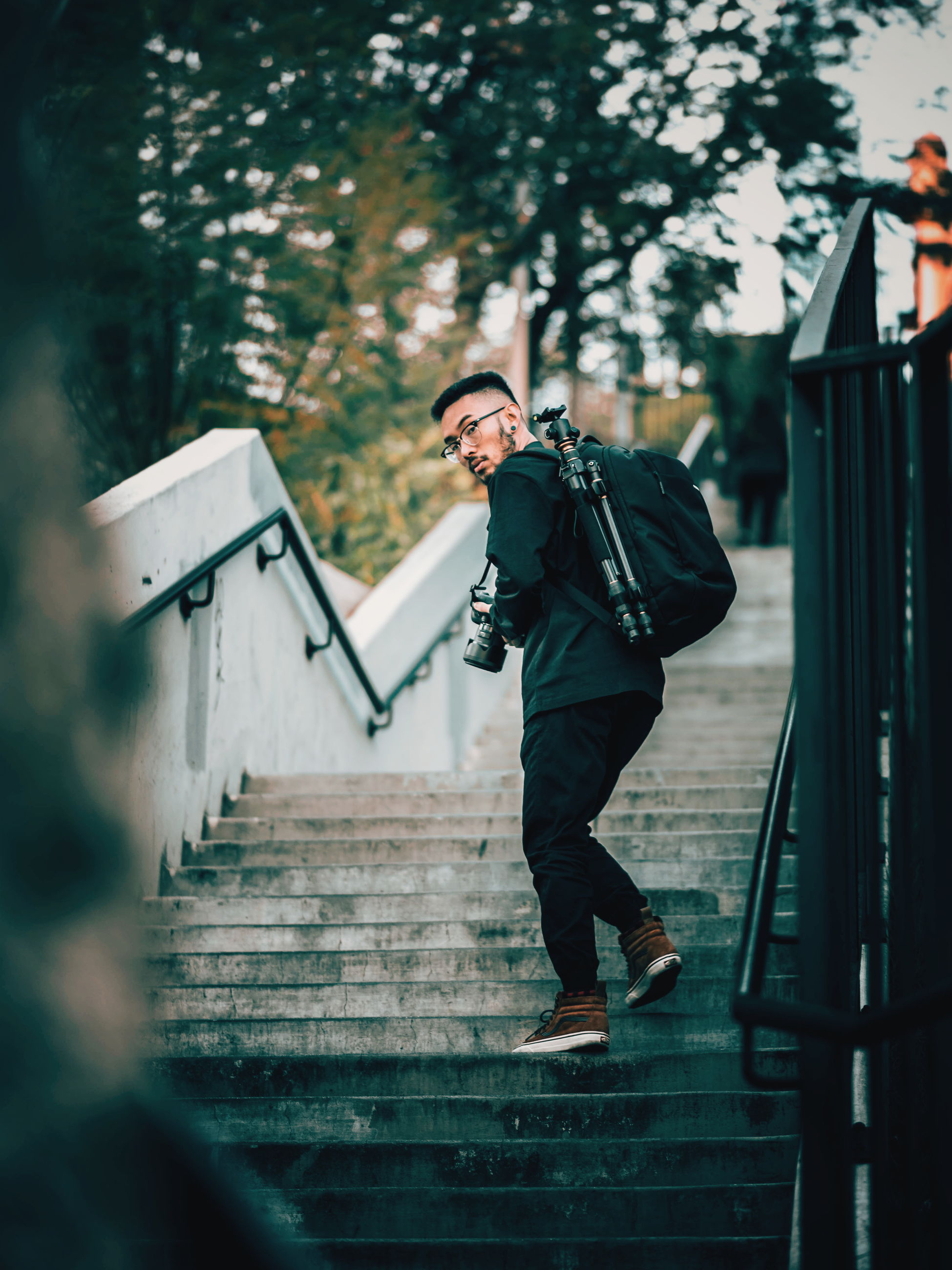 full length, one person, steps, steps and staircases, real people, running, leisure activity, walking, young adult, lifestyles, day, outdoors, men, warm clothing, people