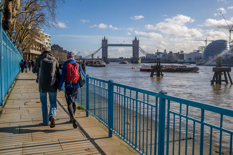 Tourists alongside River Thames Built Structure Casual Clothing City Life Cloud - Sky Day International Landmark Leisure Activity Lifestyles Outdoors River Sky Thames The Thames The Way Forward Tourist Tower Bridge  Travel Travel Photography Walking Walkway Water