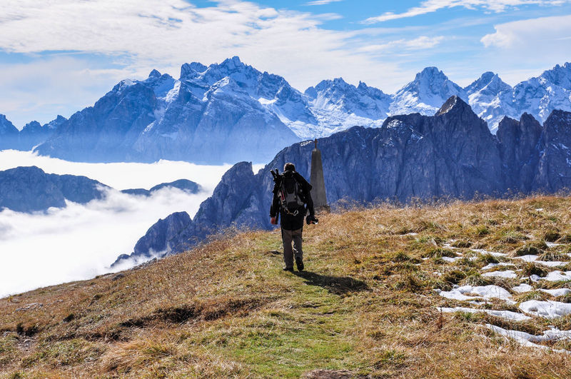 Rear view of man hiking european alps