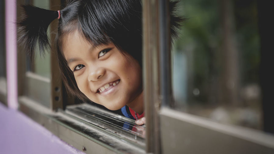 Adult Anthropomorphic Smiley Face Beautiful People Beauty Cheerful Child Childhood Close-up Day Females Girls Happiness Human Body Part Indoors  Lifestyles One Person People Portrait Smiling Window Uniqueness