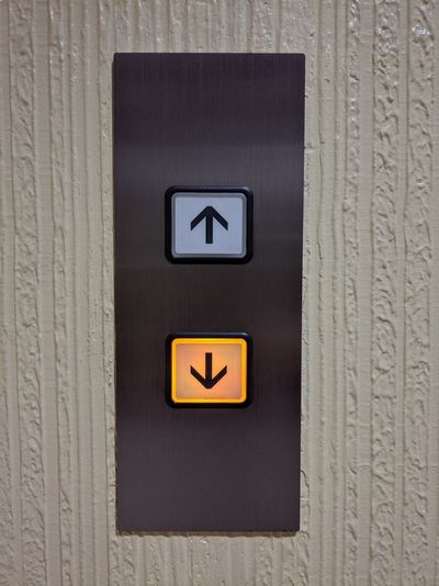 Elevator Panel Go Down Button Press The Button Pressed Button Choices Lower Elevator Button Indoors  Electricity  No People Close-up Day