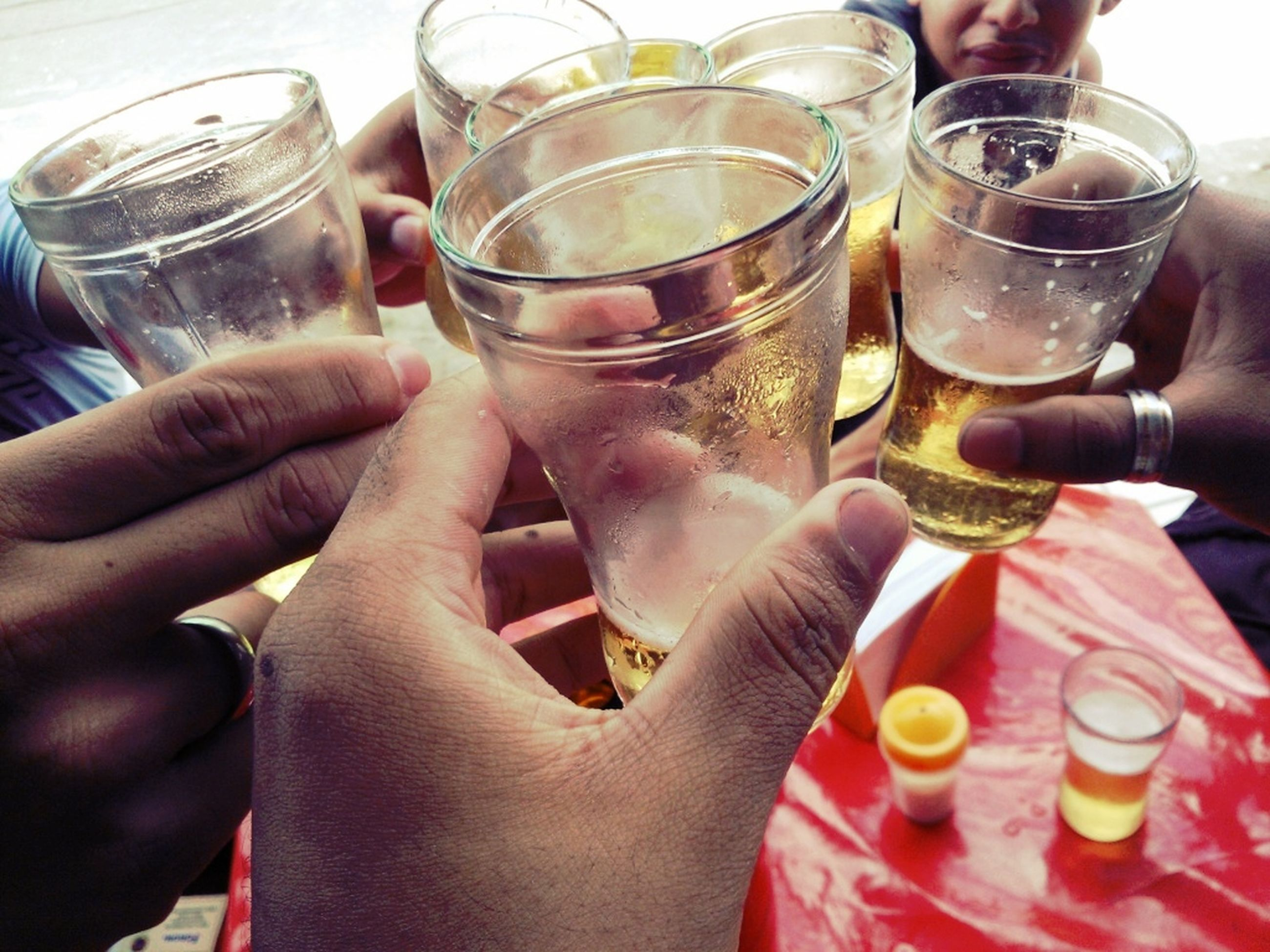 drink, person, food and drink, refreshment, drinking glass, holding, part of, alcohol, indoors, freshness, cropped, lifestyles, close-up, glass - material, human finger, wineglass, leisure activity