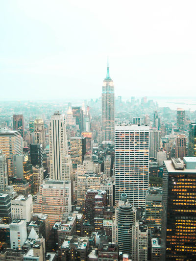 New York from Rockefeller Center Architecture Building Exterior Built Structure City Cityscape Day Downtown District Empire State Building Mist Misty Morning Modern No People Outdoor Photography Outdoors Sky Skyscraper Tower Travel Destinations Urban Skyline