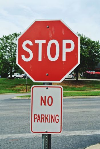 Stop no parking Sign Communication Text Road Western Script Road Sign Warning Sign Guidance Stop Sign Red City Street Stop - Single Word Information Capital Letter Transportation Information Sign No People Sky Day