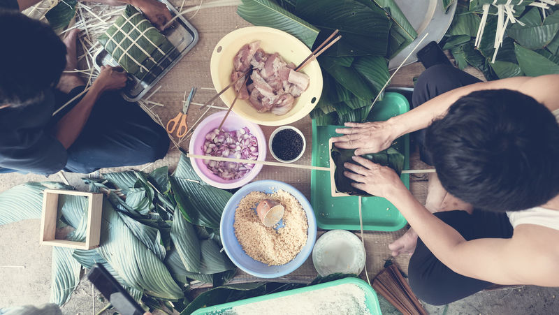 Traditional Culture Tết Bowl Breakfast Cultures Day Directly Above Food Food And Drink Freshness Fruit Healthy Eating High Angle View Indoors  Lifestyles Men People Plate Ready-to-eat Real People Table Togetherness Women