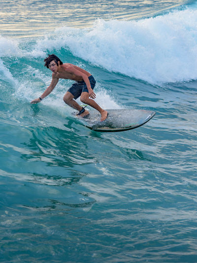 Surfing Waikiki waves Blue Cool Copy Space Day Full Length Hawaii Healthy Lifestyle Motion Oahu One Person Outdoors Pacific Ocean People Sea Skill  Speed Sport Surfing Water Wave Young Young Adult Live For The Story Sommergefühle