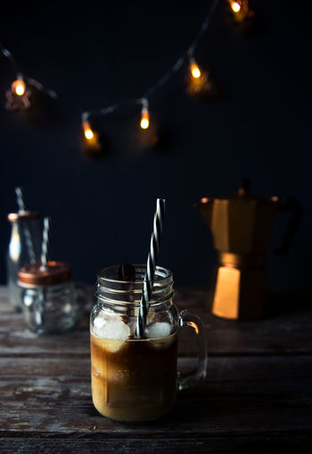 Iced Coffee Coffee Cozy Dark Background Drink Drinking Glass Freshness Home Iced Coffee Illuminated Indoors  Lights Moka Mokapot No People On The Table Refreshment Table Wood Wood - Material Food Stories The Still Life Photographer - 2018 EyeEm Awards