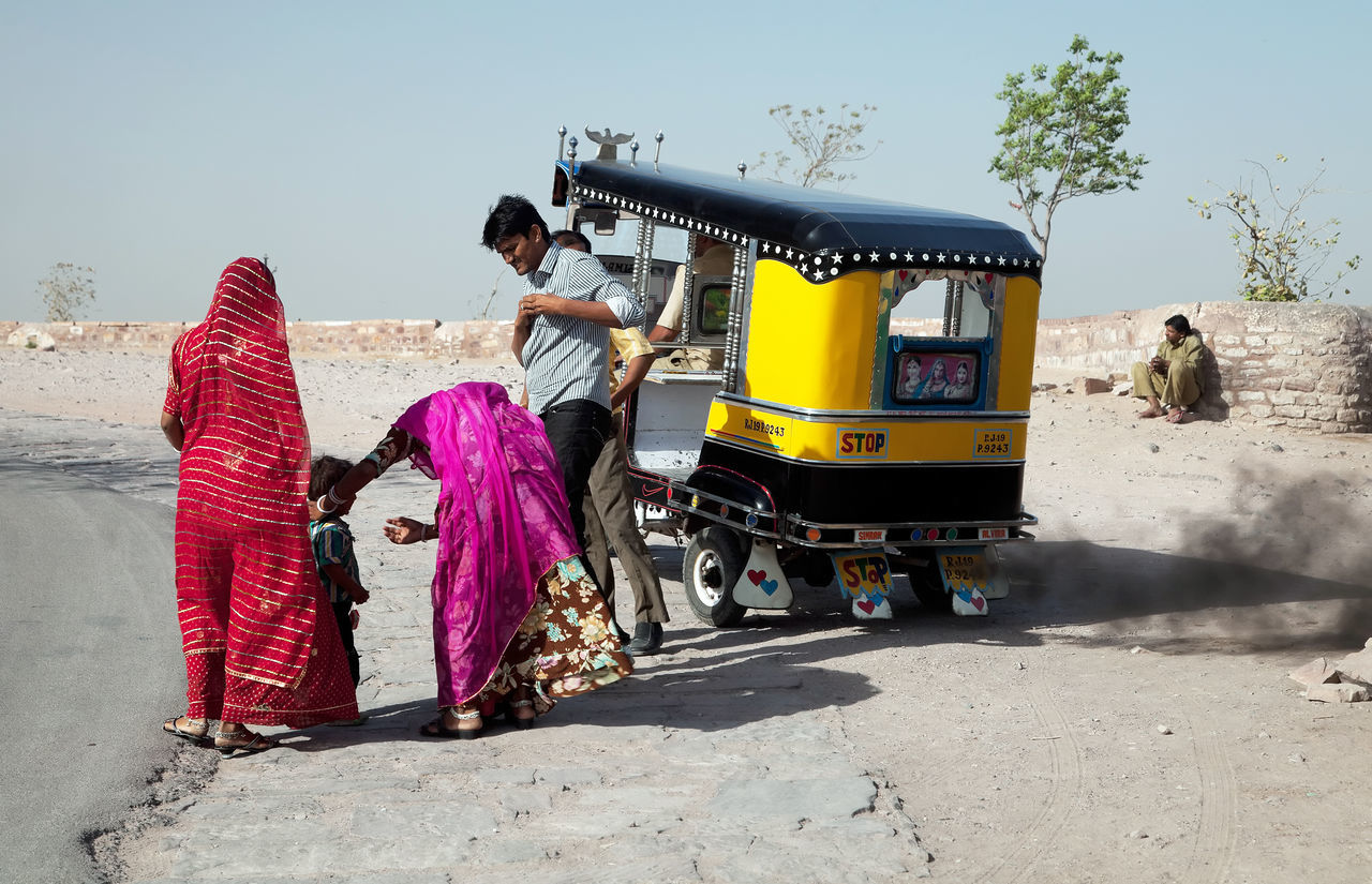 real people, men, outdoors, day, transportation, sari, sunlight, lifestyles, architecture, women, clear sky, sky, occupation
