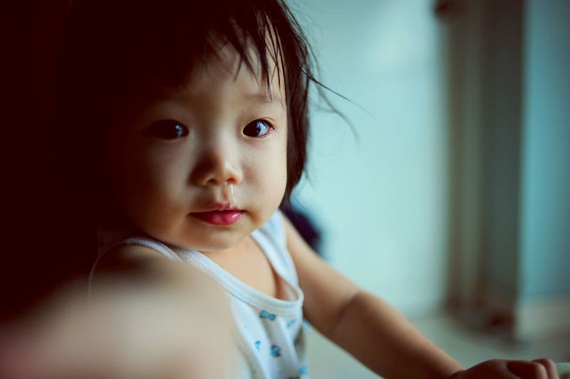Mucus flowing from nose of little baby girl Asian  RunnyNose Baby Babyhood Child Childhood Close-up Cute Flu Focus On Foreground Girl Headshot Home Interior Indoors  Innocence Looking At Camera Mucus  One Person Portrait Real People Running Nose Selective Focus Sick Toddler  Young