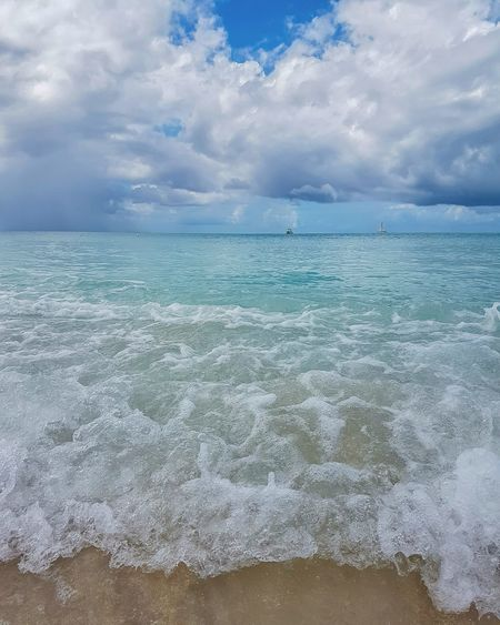 Blue Cloud - Sky Beauty In Nature Sky Abundance Scenics Dramatic Sky Nature Sea Outdoors Awe Day Tranquility No People Social Issues Horizon Over Water Landscape Natural Phenomenon Water Refraction Beach Caribbean Island Wave Carribbean Caribbean Sea