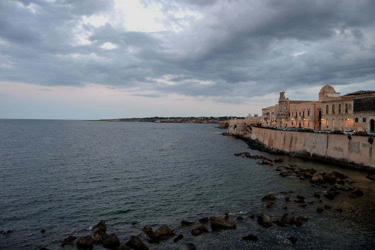 Architecture Cloud - Sky Sky Water Building Exterior Travel Destinations City Travel Tourism History Beach Landscape NikonD3100 Built Structure Nature Land Sea Tranquil Scene Dark Siracusa Ortigia.Siracusa Sicilia Italy Outdoors Nikon