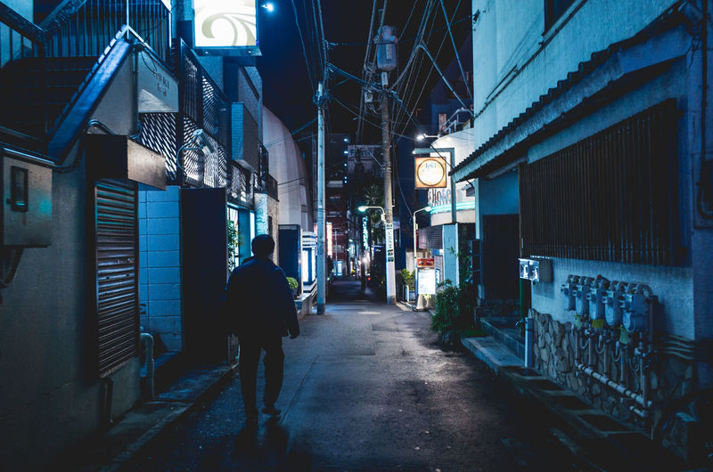 Backstreets & Alleyways Cyberpunk Man Moments Shibuyascapes Urban Exploration Walking Around Alley Architecture Building Building Exterior Built Structure City Direction Footpath Full Length Illuminated Lifestyles Lighting Equipment Men Narrow Street Night One Person Outdoors Real People Rear View Street The Way Forward Walking Way The Street Photographer - 2018 EyeEm Awards HUAWEI Photo Award: After Dark