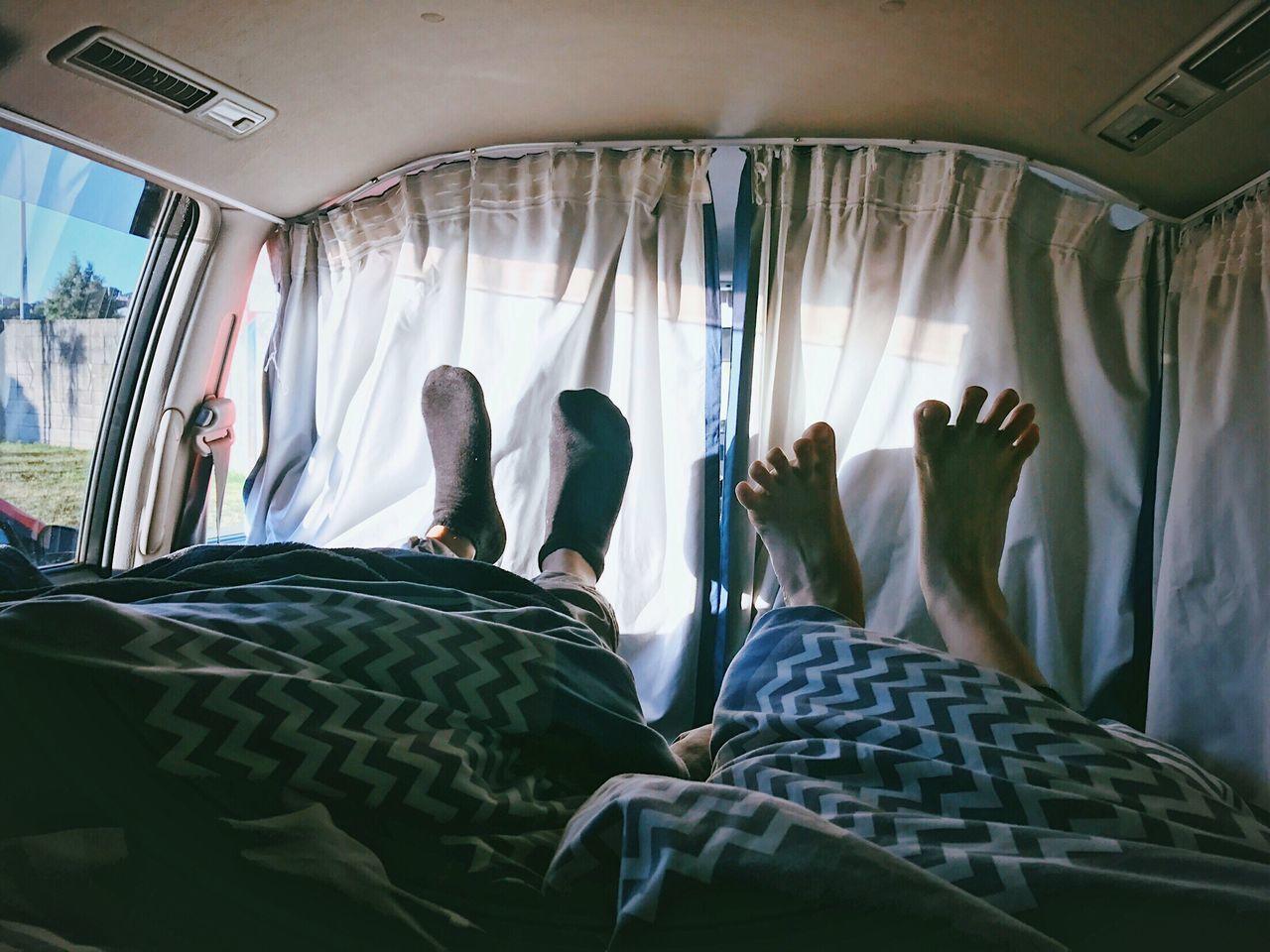 Low section of people in camper van