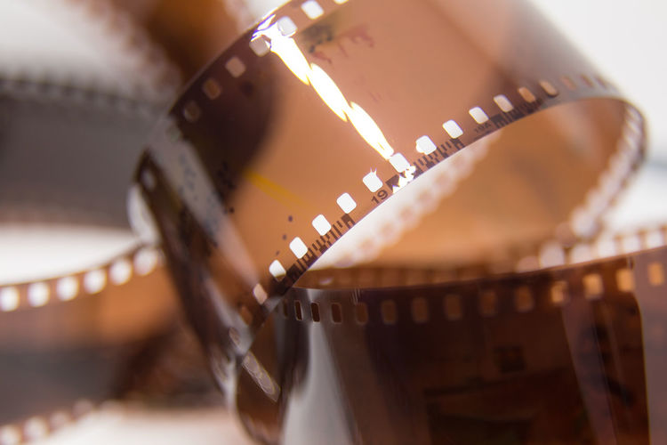 Close-up of film reel against gray background