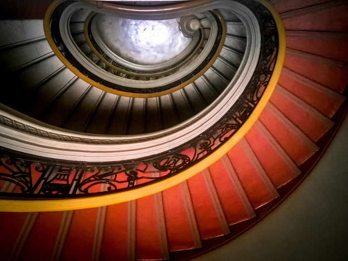 Spiralling to Heart... Staircase Steps And Staircases Railing Steps Spiral Architecture Built Structure Indoors  Spiral Staircase No People Curve Illuminated Day Heart Red Down Looling Down Interior Patterns The Architect - 2017 EyeEm Awards